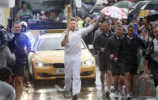 Jamie Oliver carrying to Olympic Torch