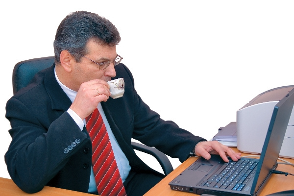 this is businessman doing his work during a coffee-break