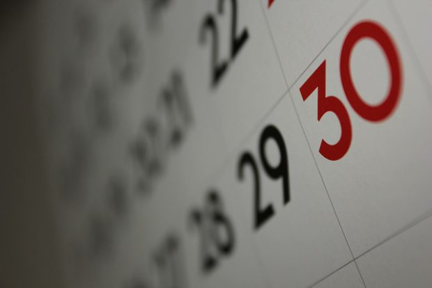 a calendar showing social ad campaigns and end of month results
