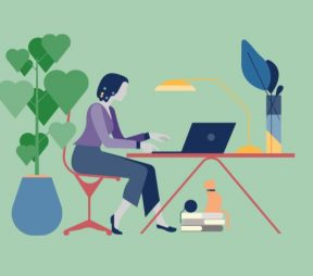 woman sitting at desk typing on laptop. plant with heart-shaped leaves to her left.