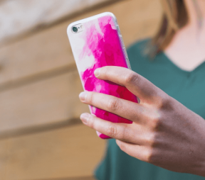 woman holding pink iPhone