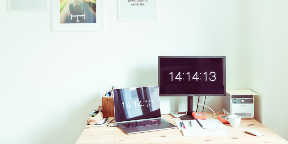 Social media workspace keeping time with two clocks on the screen