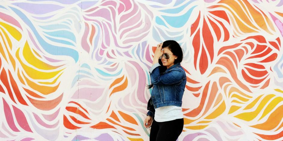 woman posing against art wall