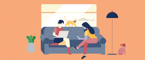 Two influencers working on a couch, with dog and cat