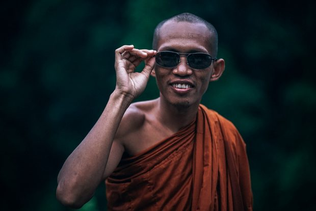 Monk wearing sunglasses